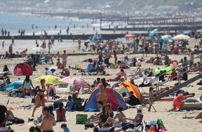 People flocked to enjoy the good weather at Bournemouth beach in Dorset. Credit: PA