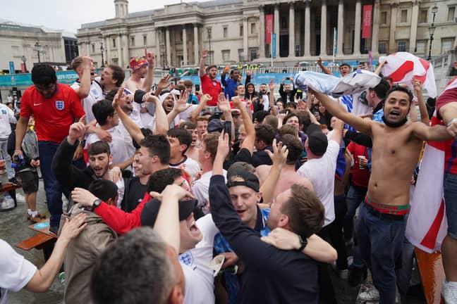 Fans celebrating at Trafalgar Square. Credit: PA