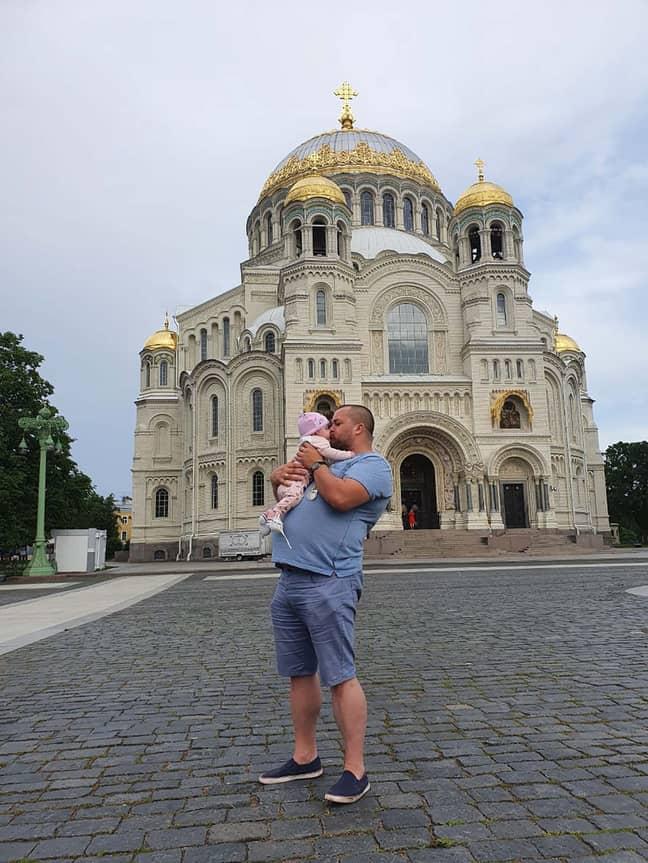 Vladimir and his five-month-old daughter Varvara. Credit: East2West
