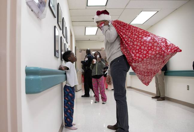 Obama became a 'stand-in Santa' for the day. Credit: PA