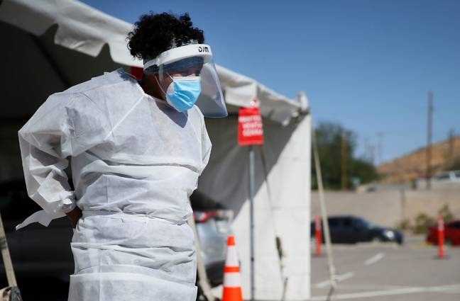 A medical worker stands at a Covid-19 state drive-thru testing site at UTEP, in El Paso, Texas. Credit: PA