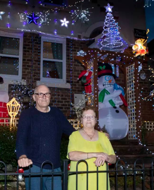 Ian and Helen switched their lights on on 1 October. Credit: SWNS