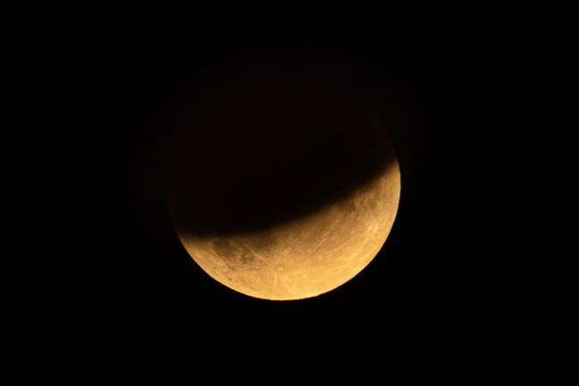 The half-blood moon spotted during a partial eclipse over London in 2019 (Credit: PA)