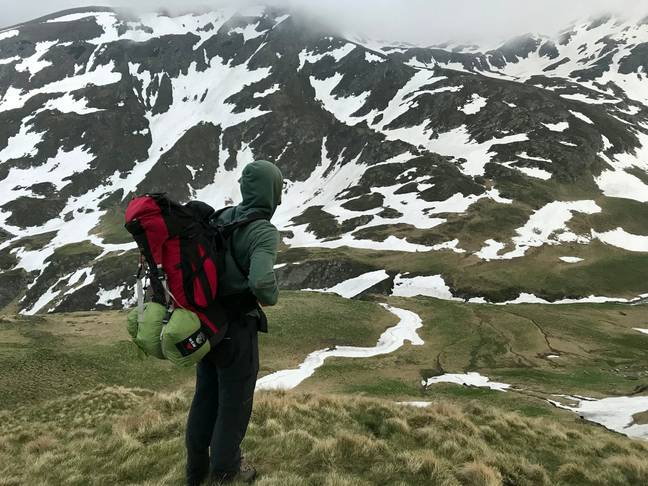 Andi Bauer and his girlfriend Lara Booth were hiking in Romania. Credit: SWNS