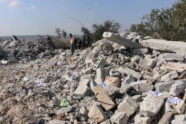 Debris of a house following the US-led raid. Credit: PA