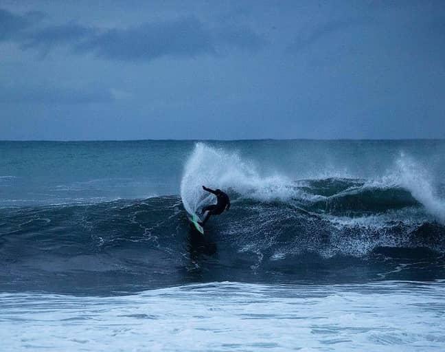 Shannon Ainslie surfing in Norway. Credit: Hallvard Kolltveit