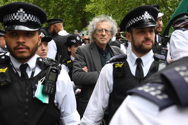 Piers Corbyn was led off by police. Credit: PA