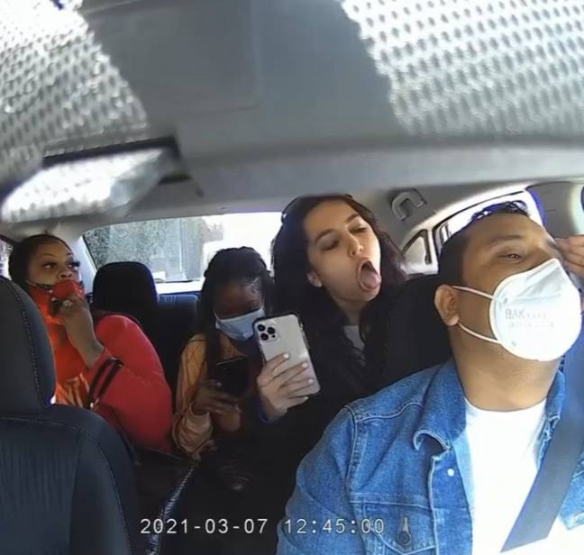 Kimiai could be seen coughing on the 32-year-old Uber driver. Credit: Nexar