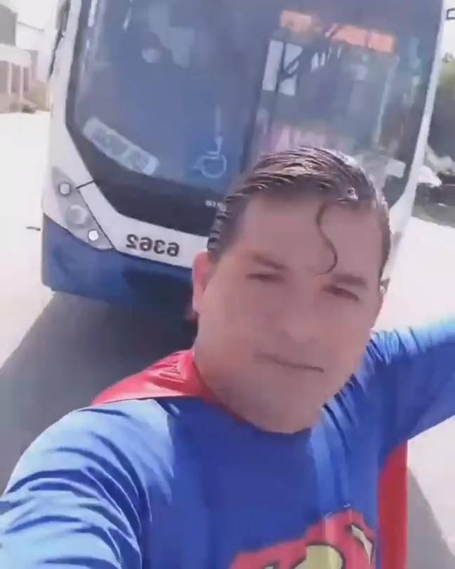 Stopping the bus... or trying to anyway. Credit: @kaleusuperman/Newsflash
