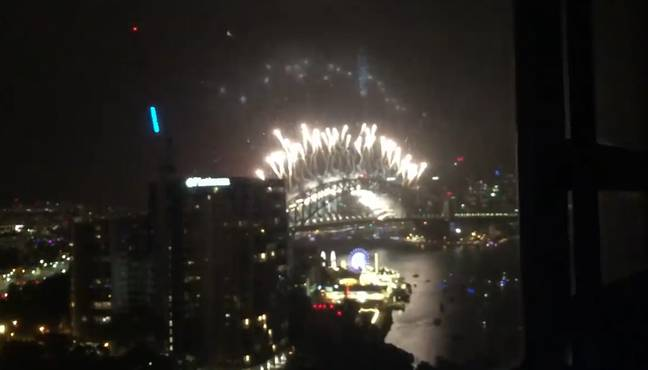 The camera then pans out to the Sydney Harbour fireworks. Credit: YouTube/TC Sweaty Ace