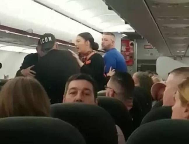 Security removed the group from the plane. Credit: SWNS