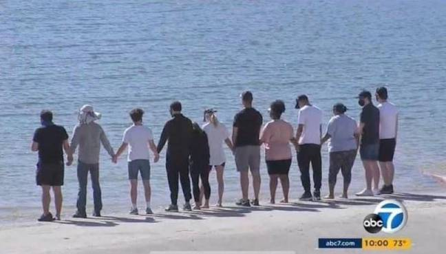 Ms Rivera's former Glee co-stars gather by Lake Piru and held hands. Credit: ABC News