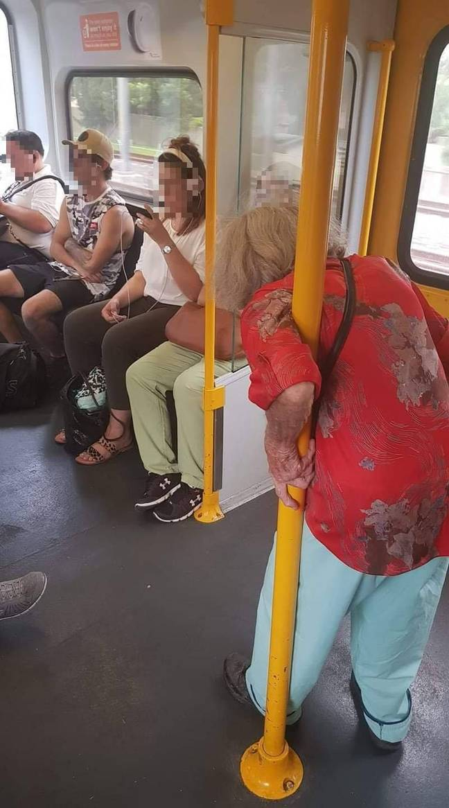 The four passengers appeared not to give up their seat for the elderly woman on the train. Credit: Facebook