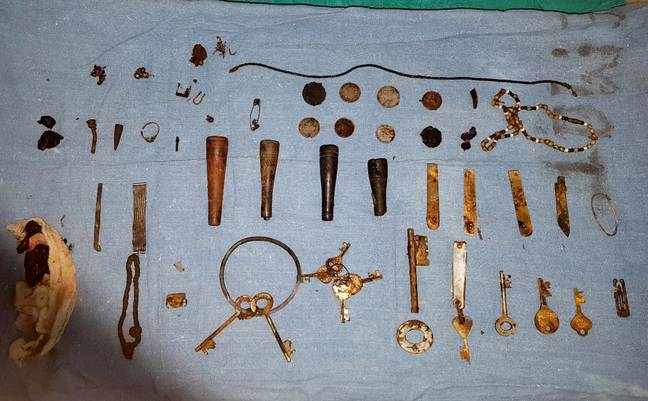 The bizarre haul included coins, knives and keys. Credit: SWNS