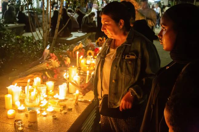 A woman lights a candle during Sabina Nessa's vigil on Friday. Credit: Alamy