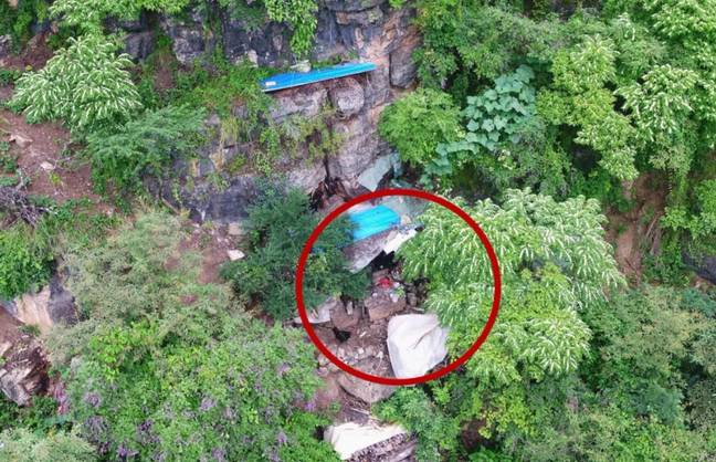 Drones caught a blue-steel tile on the cliff, which caught the attention of police. Credit: Yongshan Police