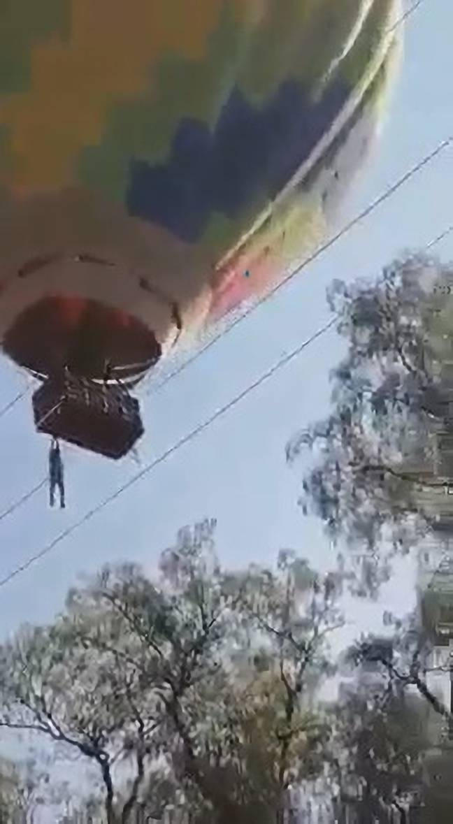 Man Clings To Hot Air Balloon As Crowds Watch On In Horror