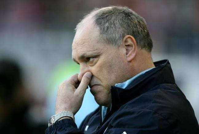 Martin Jol here, possibly trying to stop a fart invading his nostrils. Credit: PA