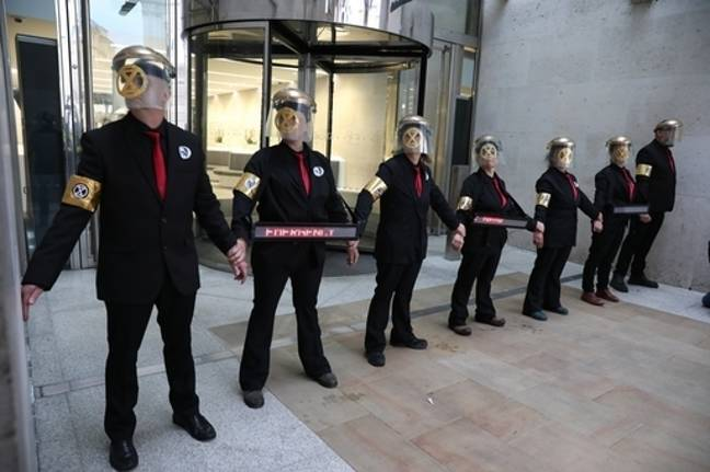 Activists glued themselves to the entrance of the London Stock Exchange. Credit: PA