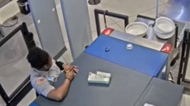 The worker writing a note. Credit: ABC7