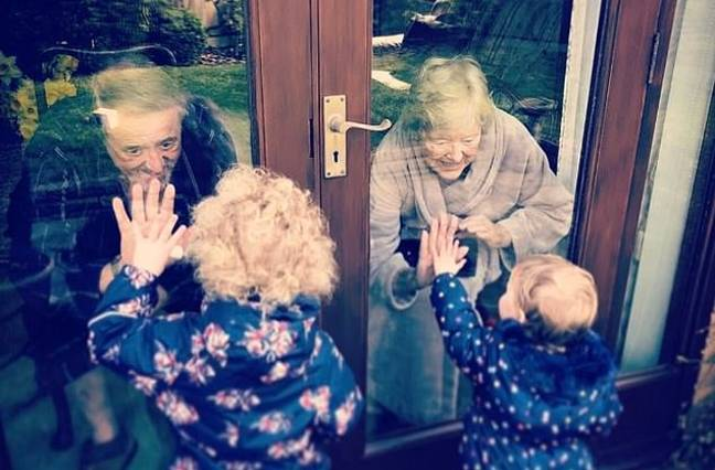 Ray and Theresa embrace their great-grandchildren. Credit: Supplied