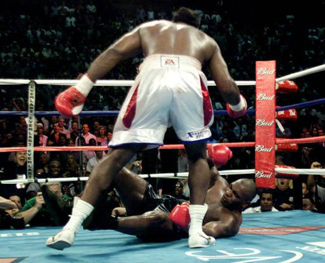 Lennox Lewis knocks out Mike Tyson in the 8th round. Credit: PA