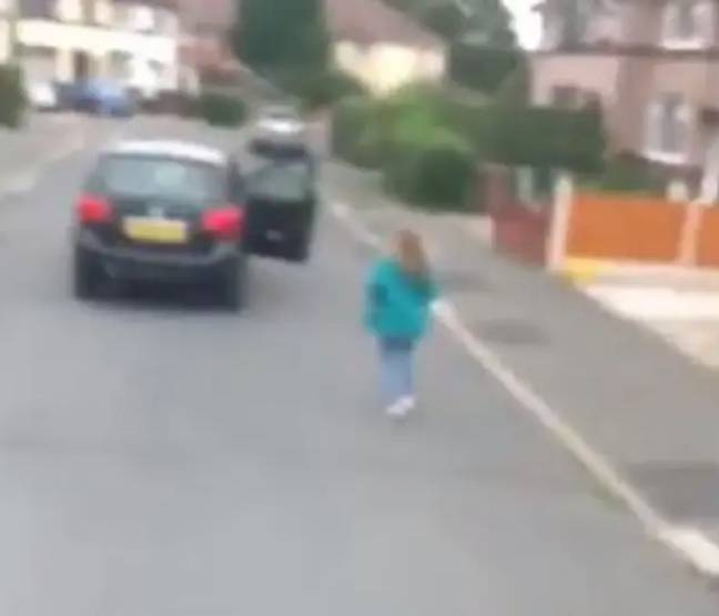The woman legs it back to her car. Credit: Liverpool Echo