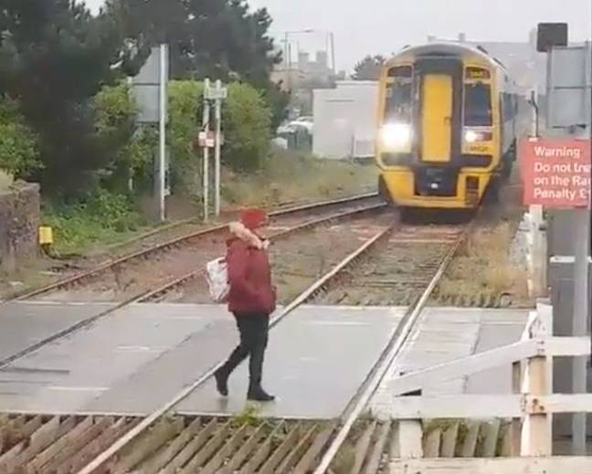 The woman didn't look like she was in a rush as she wandered on to the tracks. Credit: Wales Online