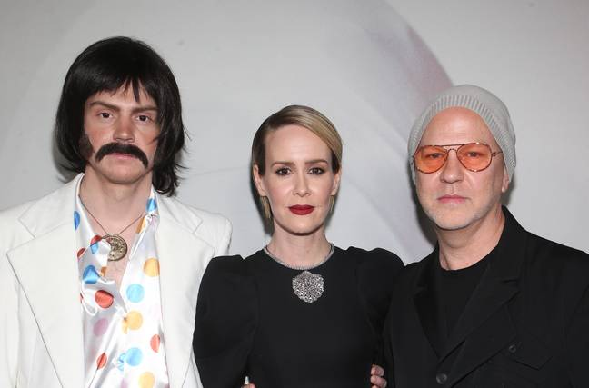 Evan Peters (in a silly costume), Sarah Paulson and Ryan Murphy. Credit: PA