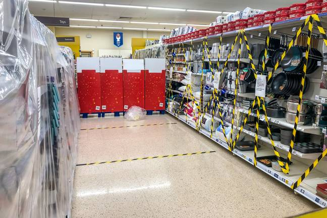 Non-essential items have been taped off in supermarkets. Credit: PA