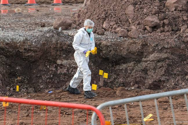 Crime scene workers search the area. Credit: Snapper SK