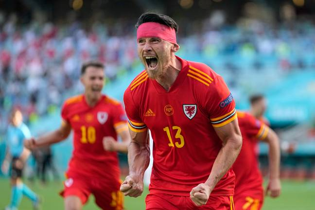 Wales' Kieffer Moore celebrates after scoring his side's opening goal during the Euro 2020 match between Wales and Switzerland. Credit: PA