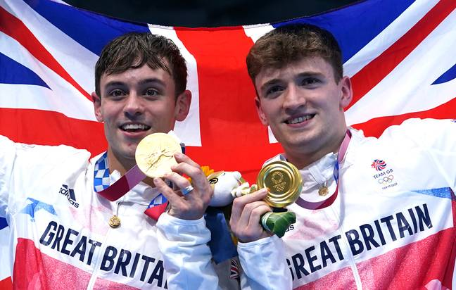 Tom Daley and Matty Lee winning gold medals for the men's 10m synchronised dive. (Credit: PA)
