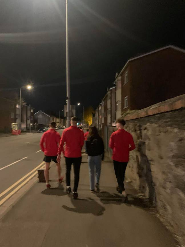 The lads walking a fellow student home. Credit: Kennedy News and Media
