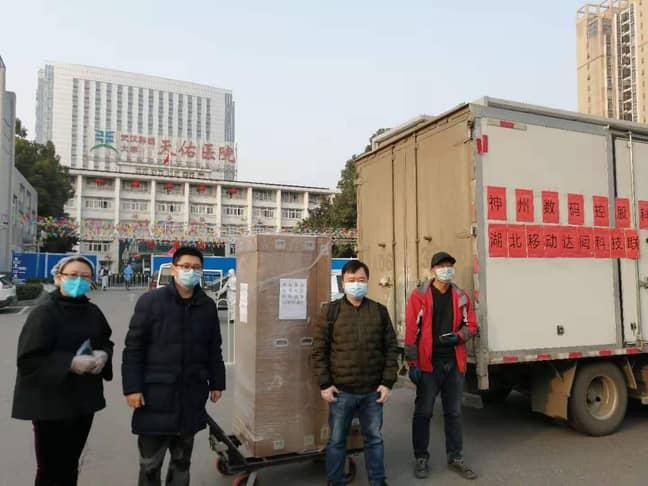 CloudMinds employees unload a robot shipment at Wuhan's Tongji Tianyou Hospital. Credit: CloudMinds