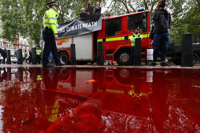Protesters lost control of the hose while trying to cover the Treasury in blood. Credit: PA