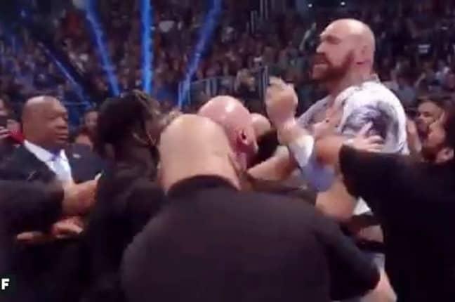 Imagine the scrap between these two behemoths... Credit: WWE