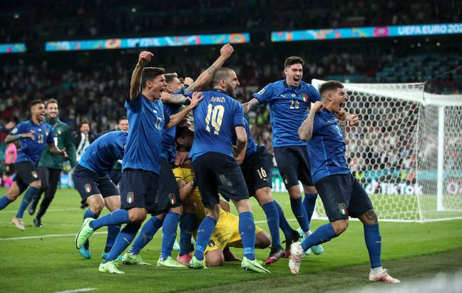 Italy celebrate their victory. Credit: PA