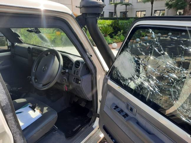 The car's window shattered by bullets. Credit: Twitter