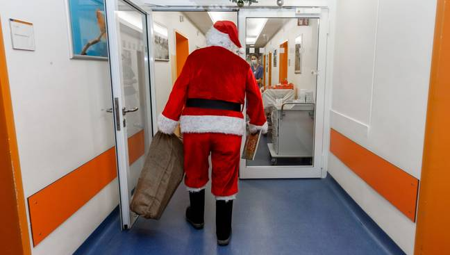 File image of a man dressed as Santa. Credit: PA