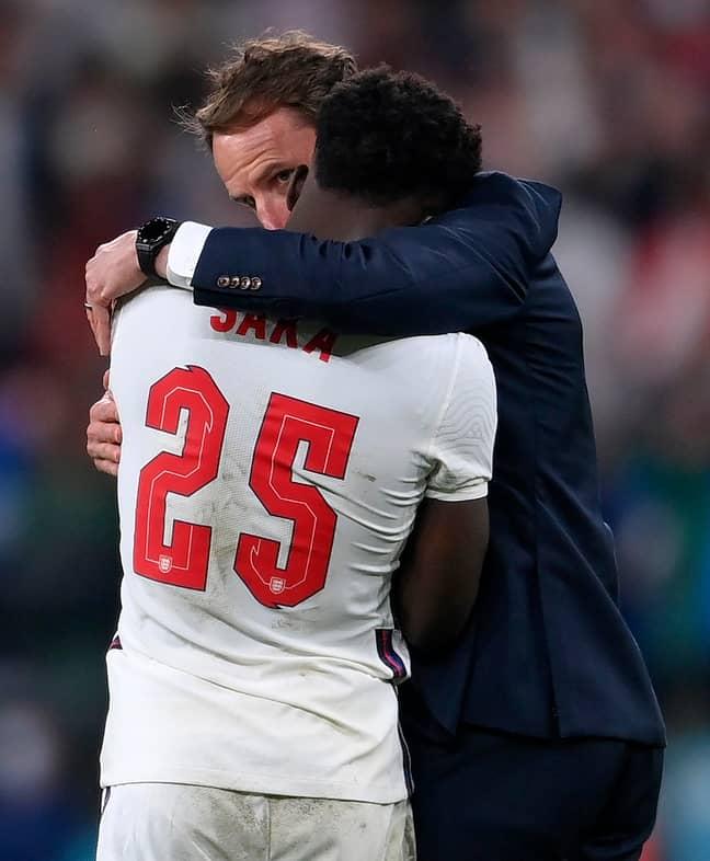 England's manager Gareth Southgate, right, hugs England's Bukayo Saka. Credit: PA