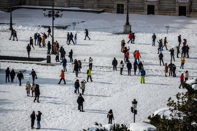 People in a snow-covered Oriente square in downtown Madrid. Credit: PA