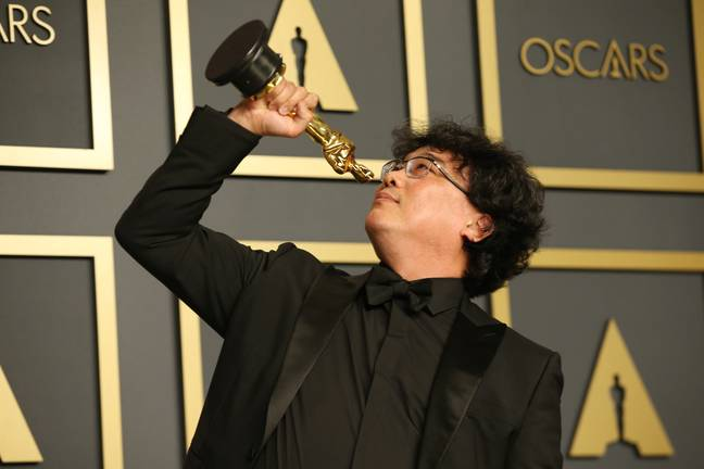 Bong Joon-ho with one of his many Oscars. Credit: PA