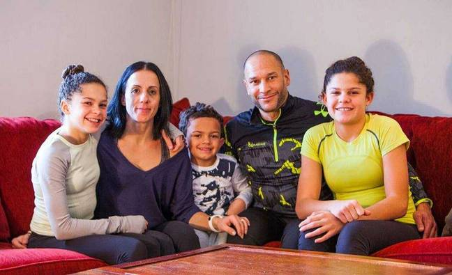 John DePass, 46, with wife Dora, 45, and their three children Michaila, 15, Sierra, 14 and Aniken, 7. Credit: Kennedy News and Media