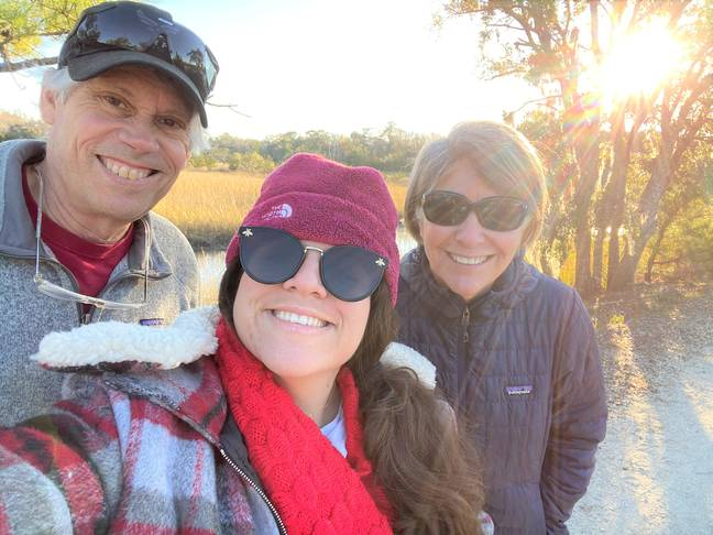 Mariela with her adoptive parents Lisa and Pete. Credit: SWNS