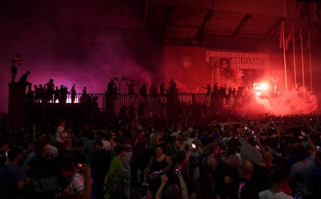 Fans outside Anfield. Credit: PA