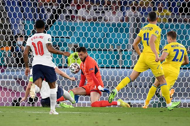 Harry Kane clips home England's opener. Credit: PA