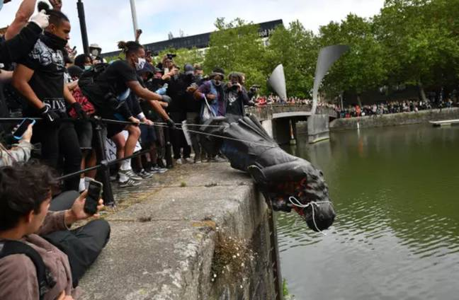 The statue of slave owner Edward Colston was thrown into the harbour by protesters. Credit: PA