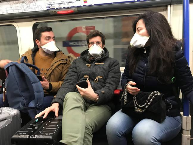 People wearing face masks on the London Underground. Credit: PA
