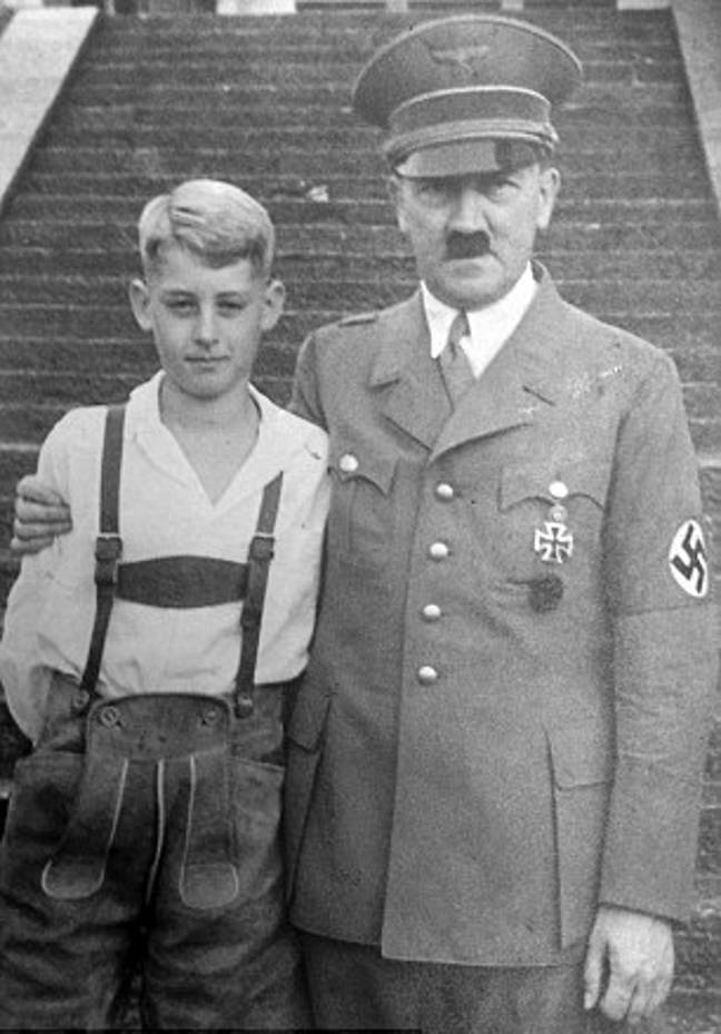 Lutz's son standing with Hitler. Credit: Hansons Auctioneers/BNPS